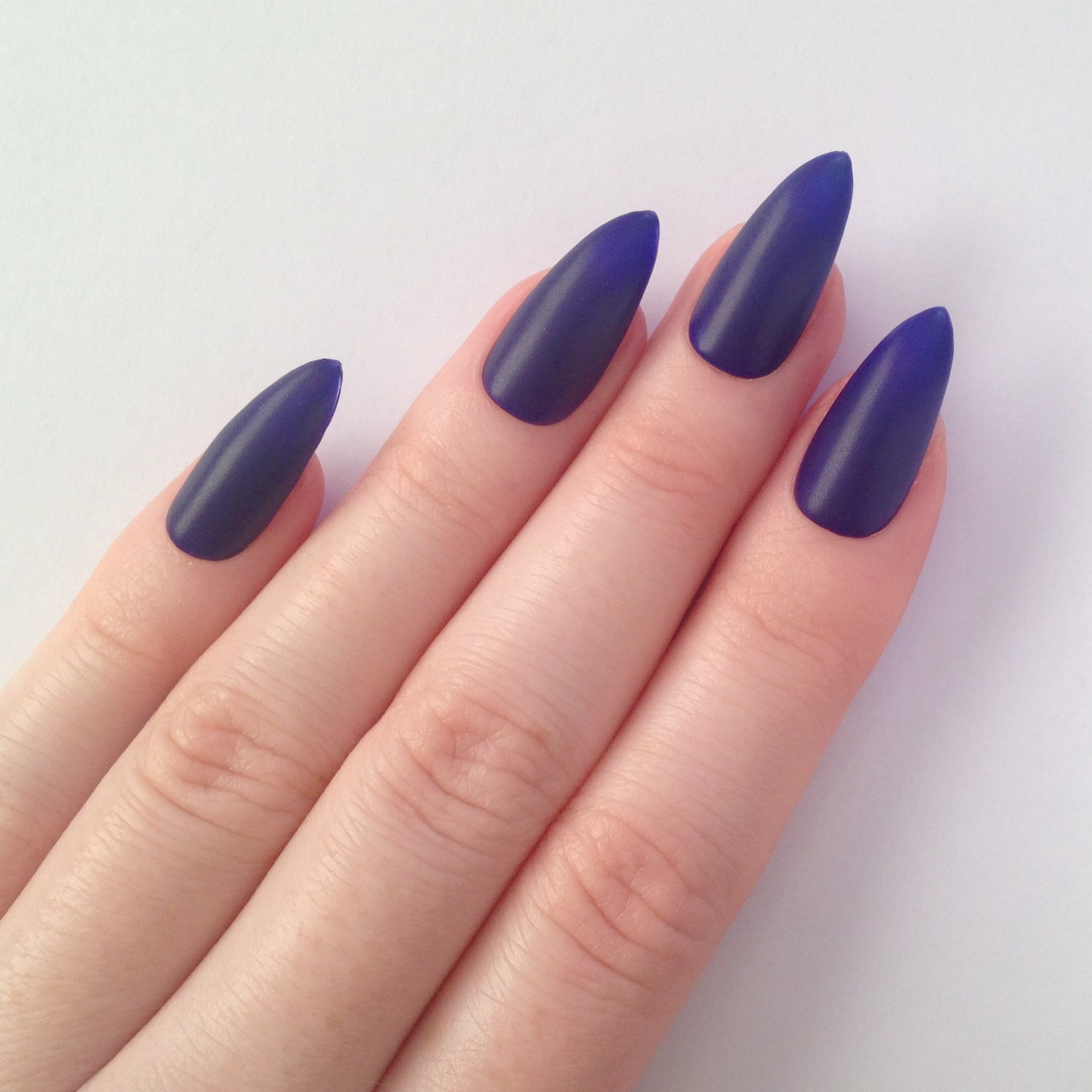 Stiletto purple nails!