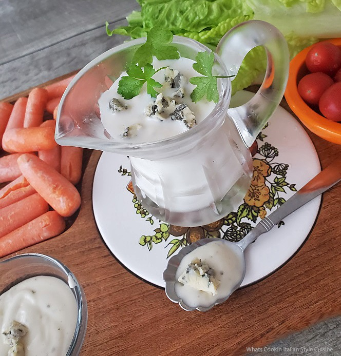 this is a photo of homemade Buttermilk blue cheese dressing in a pourable glass pitcher