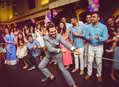 3Esha-Deol-enjoys-a-game-of-tug-of-war-at-her-baby-shower