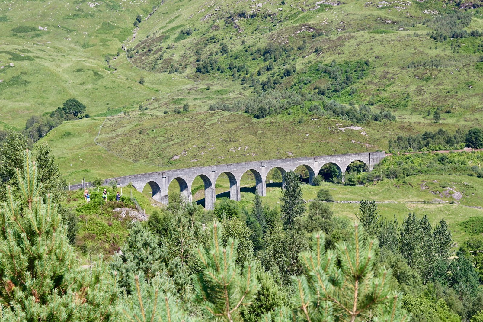 Glenfinnan Viaduct, Jacobite steam train passing along the bridge, CalMcTravels