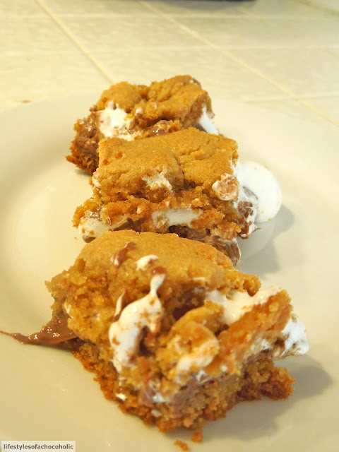 three smores bars on a white plate on white counter