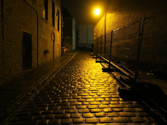 Cobbled street at night in the rain with street light. Halifax, West Yorkshire