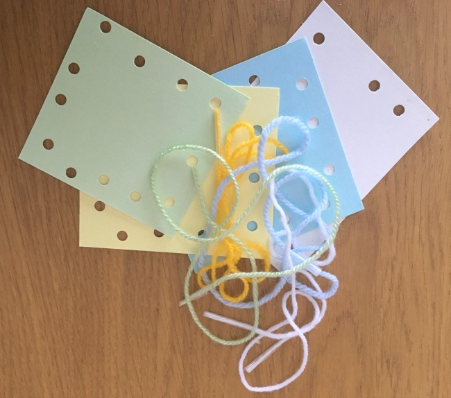 5-minute-games-for-toddlers-lacing-finished-card-with-yarn