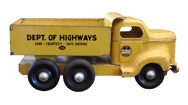 A yellow Dept. of Highways trucked produced by Otaco in Orillia.