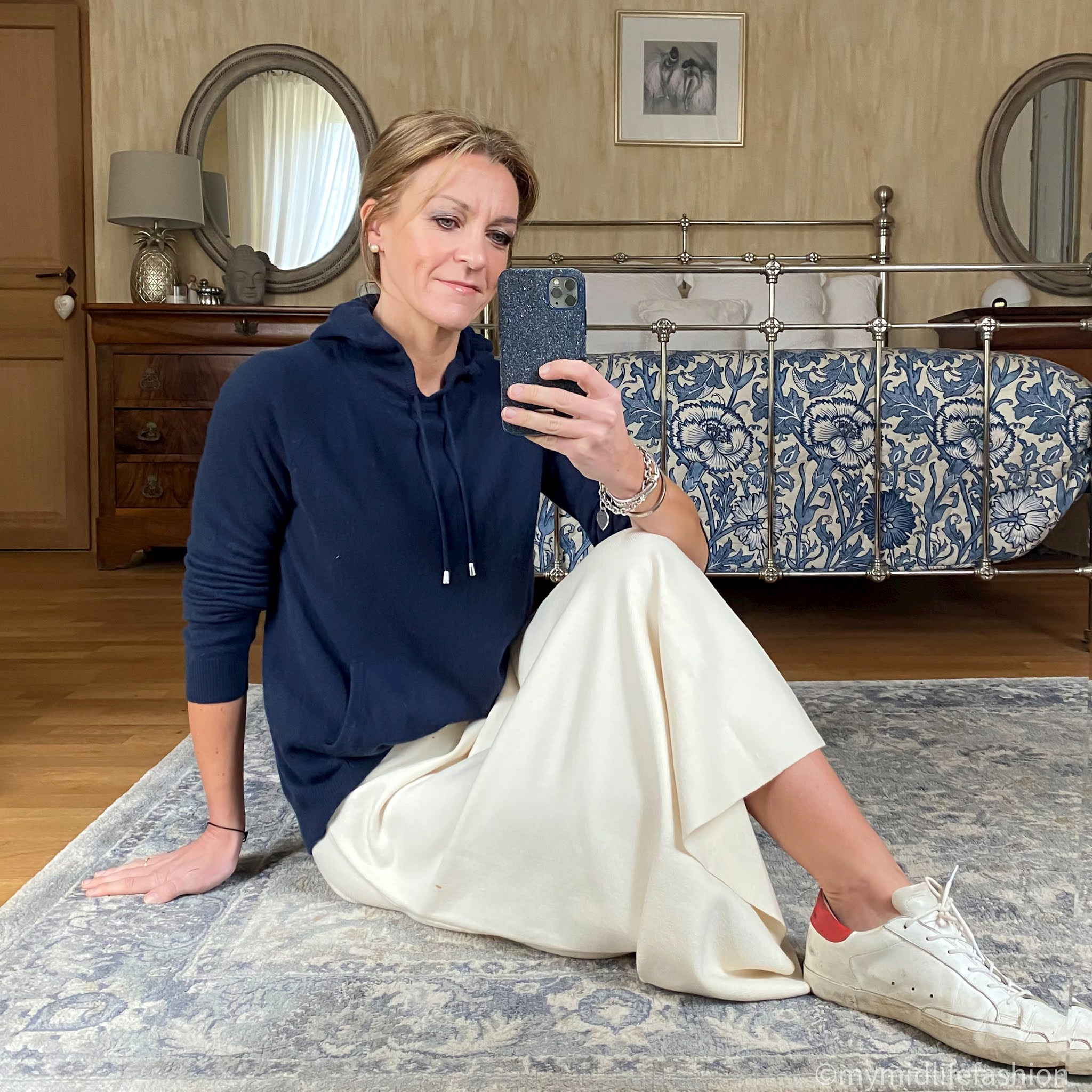 my midlife fashion, marks and Spencer pure cashmere hoodie, next a line knitted skirt, golden goose superstar low top leather trainers