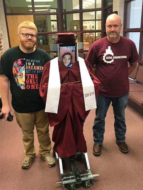 Highschool student was injured in a car wreck and hospitalized right before graduating so his friends built him a robot to collect his diploma