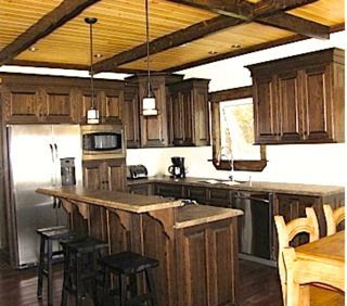 Cottage kitchen with wood ceiling beams.