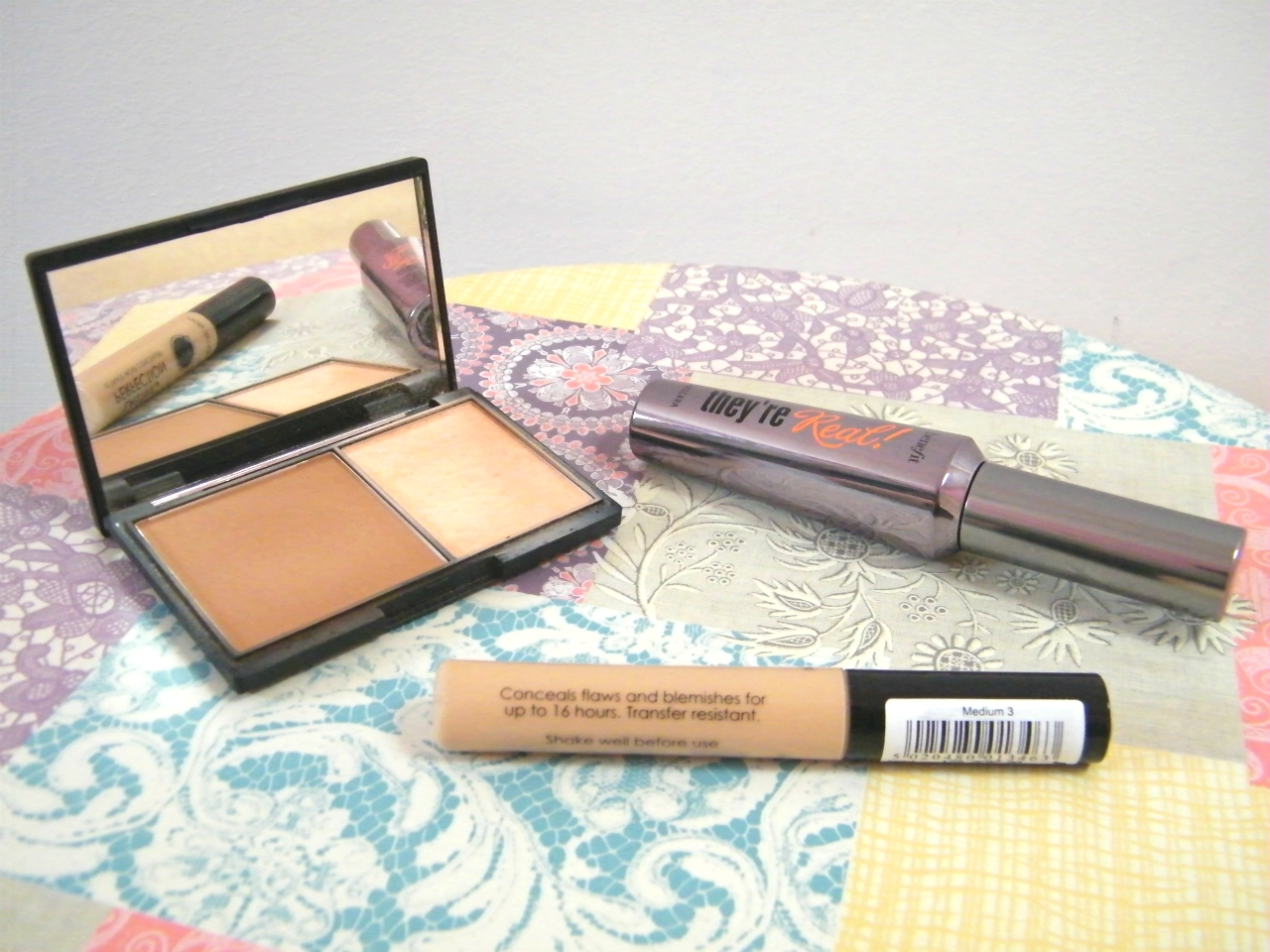 Sleek Face Contour Kit, Benefit They're Real Mascara and Collection Lasting Perfection Concealer