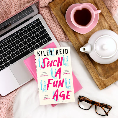 Kiley Reid Such a Fun Age Book Review - Book on Top of Laptop with Cup of Tea and Reading Glasses