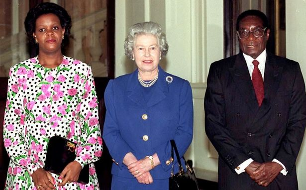 The Queen With President Mugabe Of Zimbabwe and his wife at Buckingham Palace.