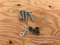1 inch carriage bolts, lock washers and nuts