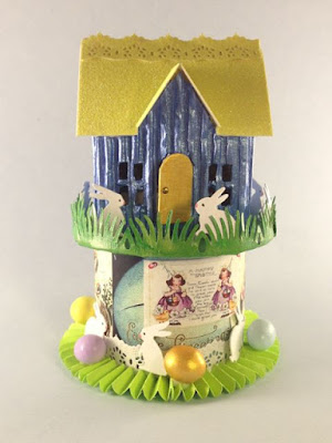 Tiny house surrounded by bunnies and eggs
