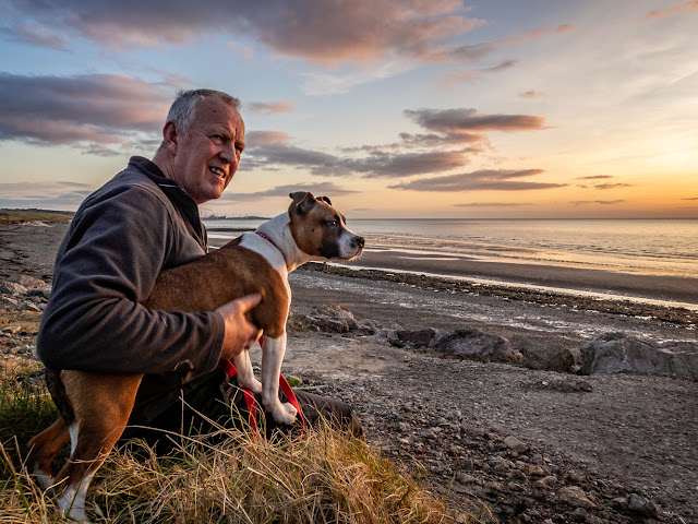 Photo of Phil and Ruby waiting for sunset on the shore at Maryport