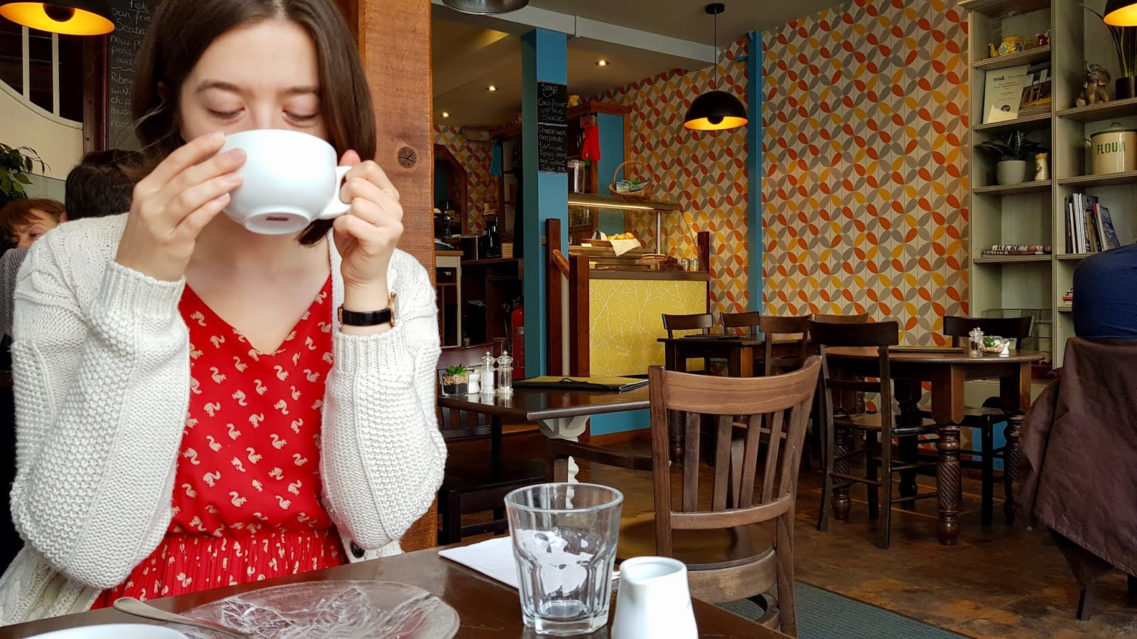 Abbey sipping on a coffee at The Bay Tree Cafe, Bury St Edmunds