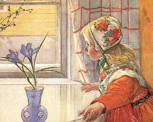 Little girl is looking through window