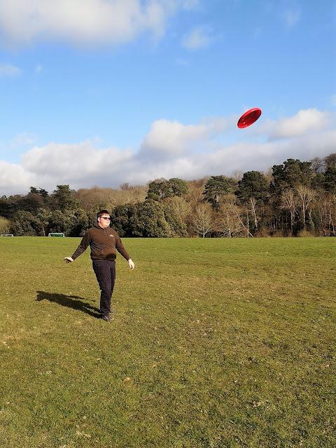 Teen throwing frisbee