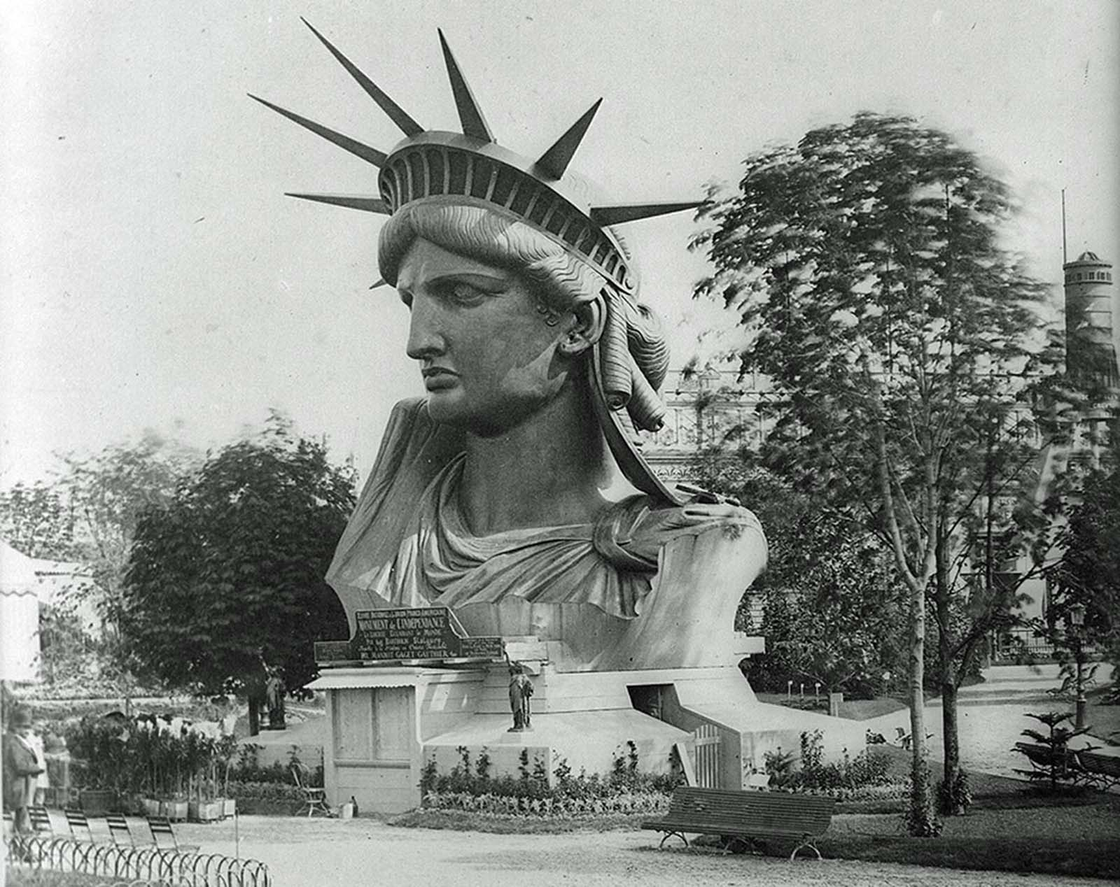 The head of the Statue of Liberty, on display in a park in Paris, France, in 1883.
