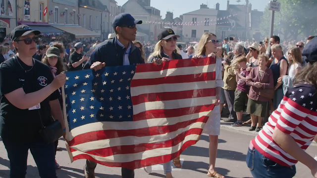 Men and women march in a D-Day parade