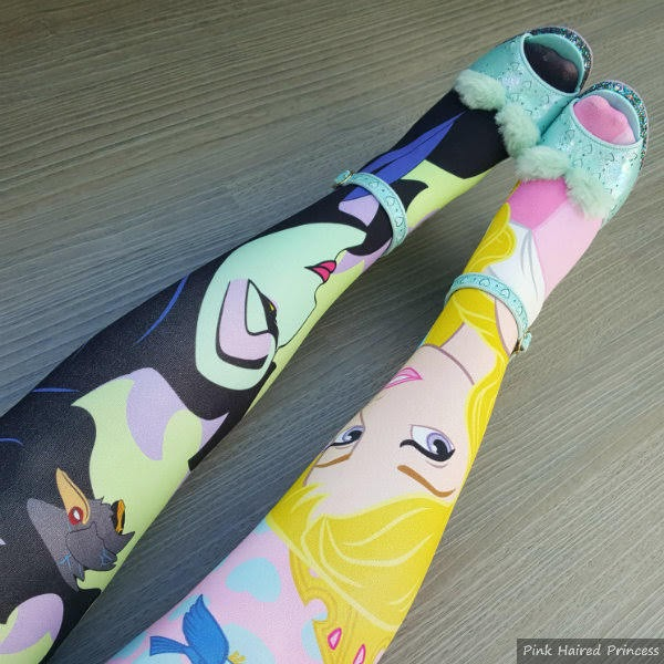 legs wearing Maleficent and Aurora character print tights with mint fluffy shoes