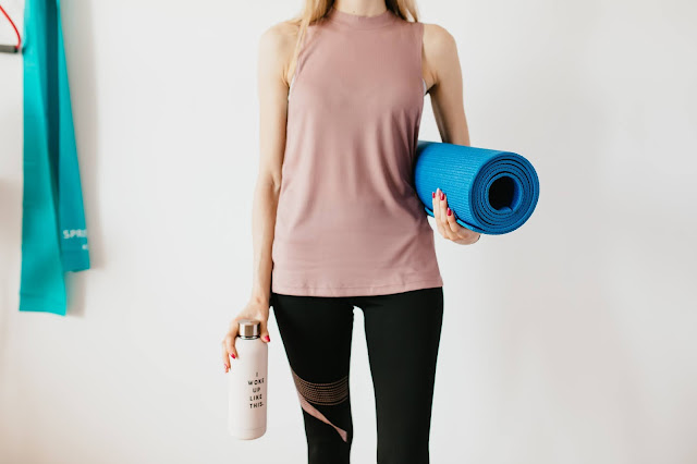 Girl with Yoga Mat and Water Bottle