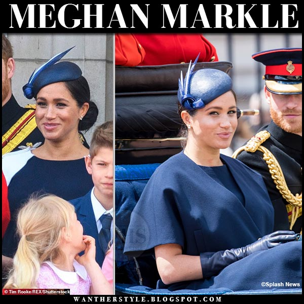 Meghan Markle in navy blue cape coat and navy and white givenchy dress. Duchess of Sussex Trooping the Colour 2019 outfit