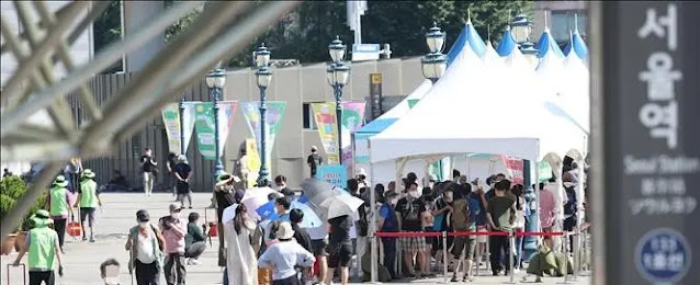 People wait in line to get tested for COVID-19 in Seoul, South Korea, on July 25, 2021. Photo Yonhap