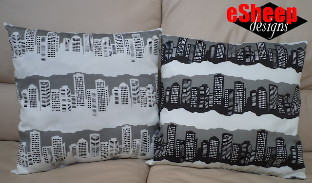 Throw pillows in Winter in the City fabric designed by eSheep Designs
