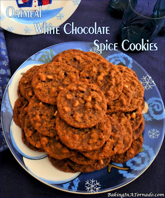 Oatmeal White Chocolate Spice Cookies are a favorite seasonal cookie reinvented. A little chewy, a little sweet and filled with big bold spice flavors. | Recipe developed by www.BakingInATornado.com | #recipe #cookies