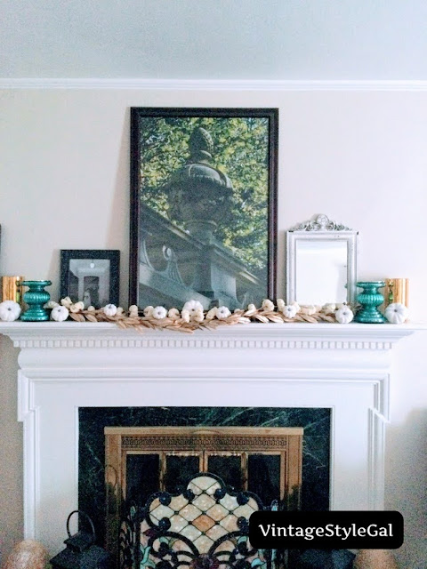 Add in small white pumpkins all over mantel