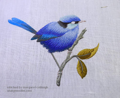 Thread painted blue bird: everything stitched except for the eye