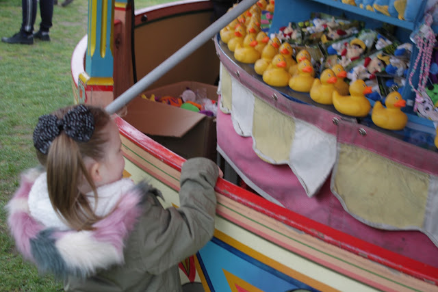 My niece having a game of Carters Steam Fair hook a duck to win a prize.