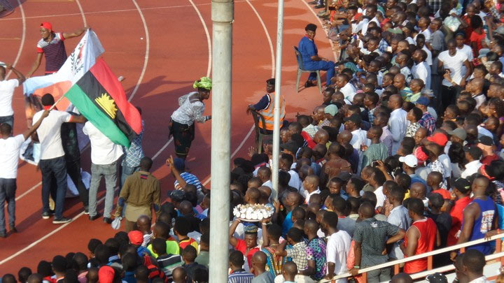 Security agents watch haplessly as Biafrans wave flag during Rangers Match