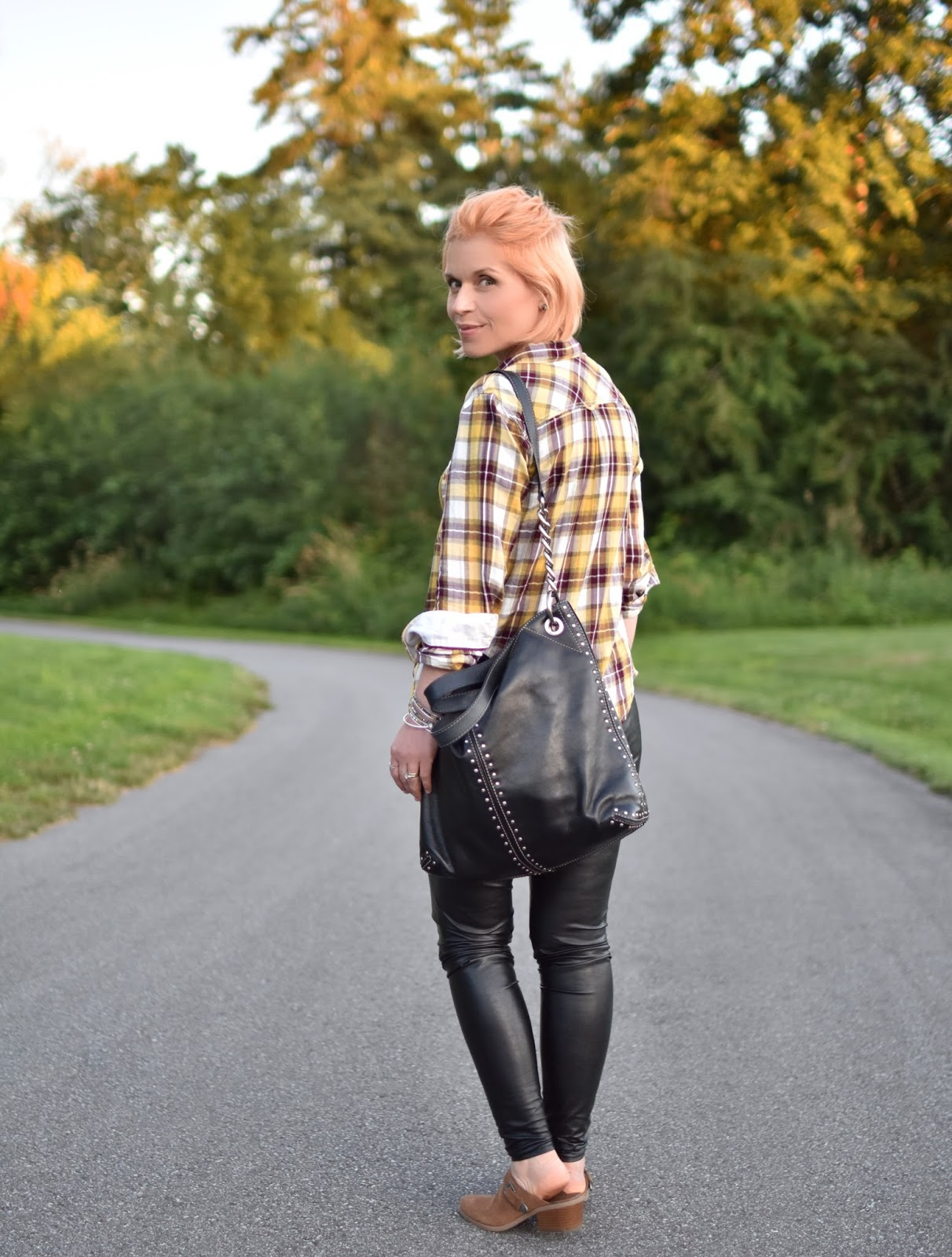 styling vegan leather leggings with a slouchy tee, plaid shirt, and AEO western-inspired mules