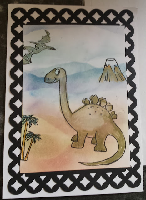 "Dinosaurs  on hand coloured 5"" x 7"" white card"