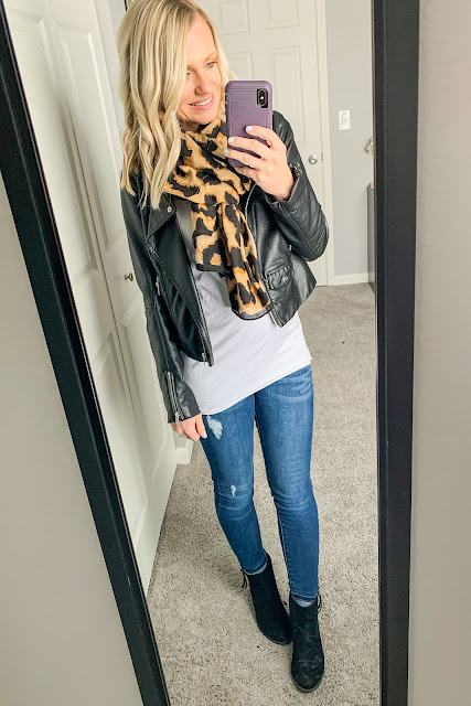 Maternity outfit with a moto jacket