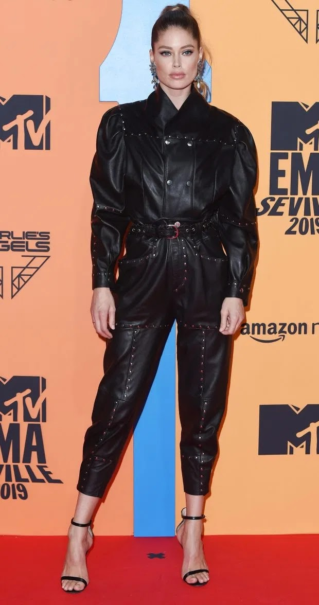 Supermodel Doutzen Kroes channelled her inner rock chick with this studded black leather jumpsuit