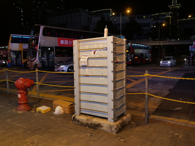 traffic control box surrounded by secure bars in Yau Ma Tei, Hong Kong