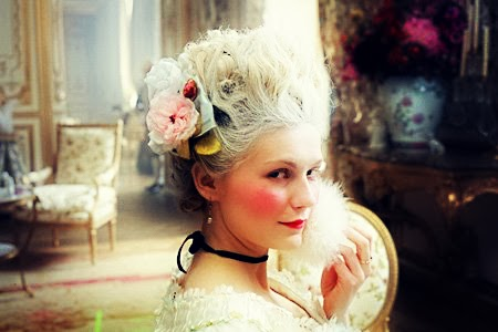 Marie Antoinette from the film with a powder puff