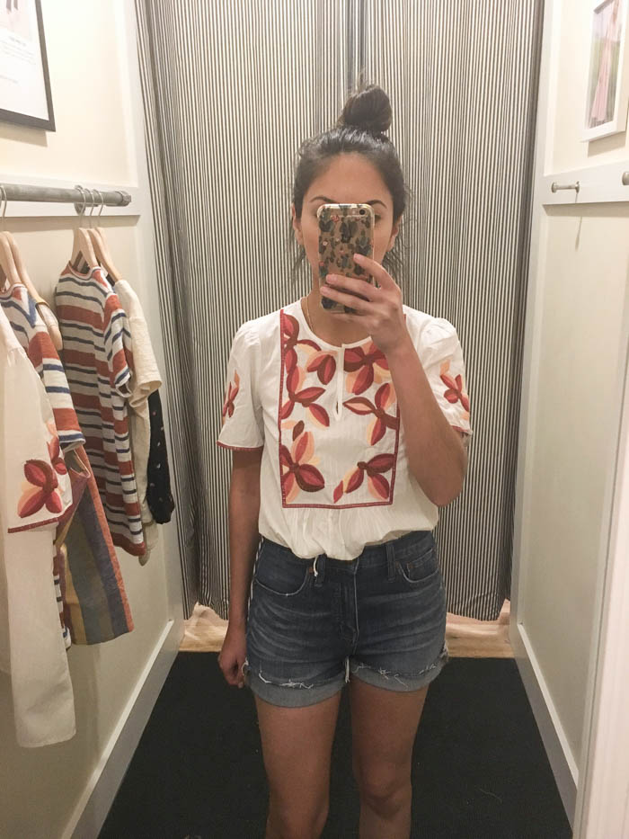 white floral top and cut off shorts
