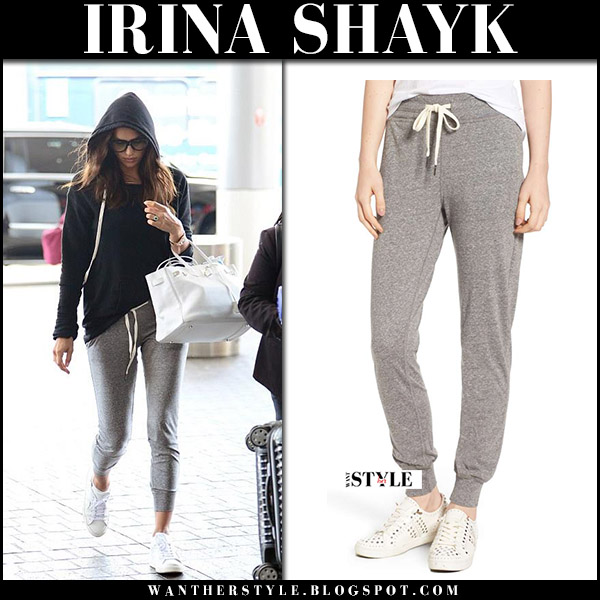 Irina Shayk in black hoodie and grey sweatpants celebrity airport travel chic style august 2017