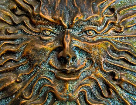 bronze cast sun face