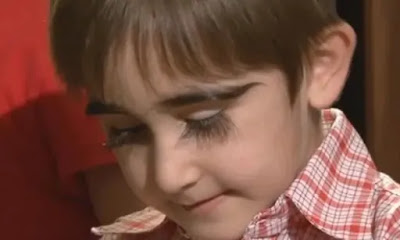 11 year old child has the longest eyelashes in the world .. She can cover his face
