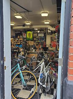 McCrank's doorway - shop full of bikes and bike parts