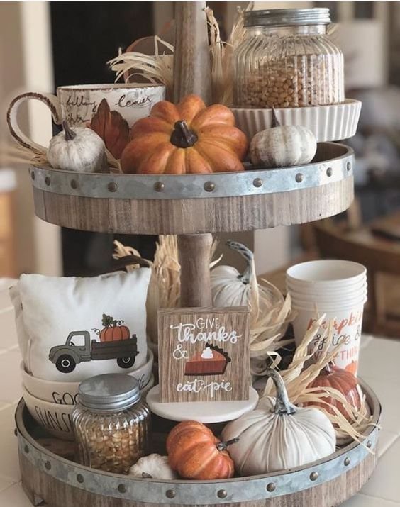 Rustic wooden tiered tray with pumpkins and Thanksgiving theme