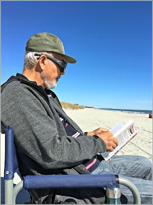 February 14, 2019 Reading on the beach.