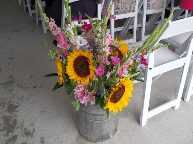 wedding flowers in a milk churn