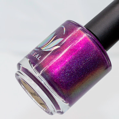 violet shimmer polish with holographic flakies in a polish bottle