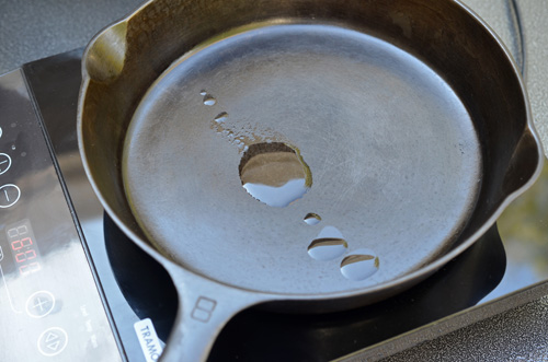 Seasoning a Griswold #8 cast-iron skillet - go sparingly with the oil