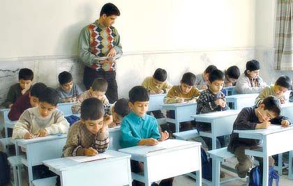 Elementary school teacher dictating students