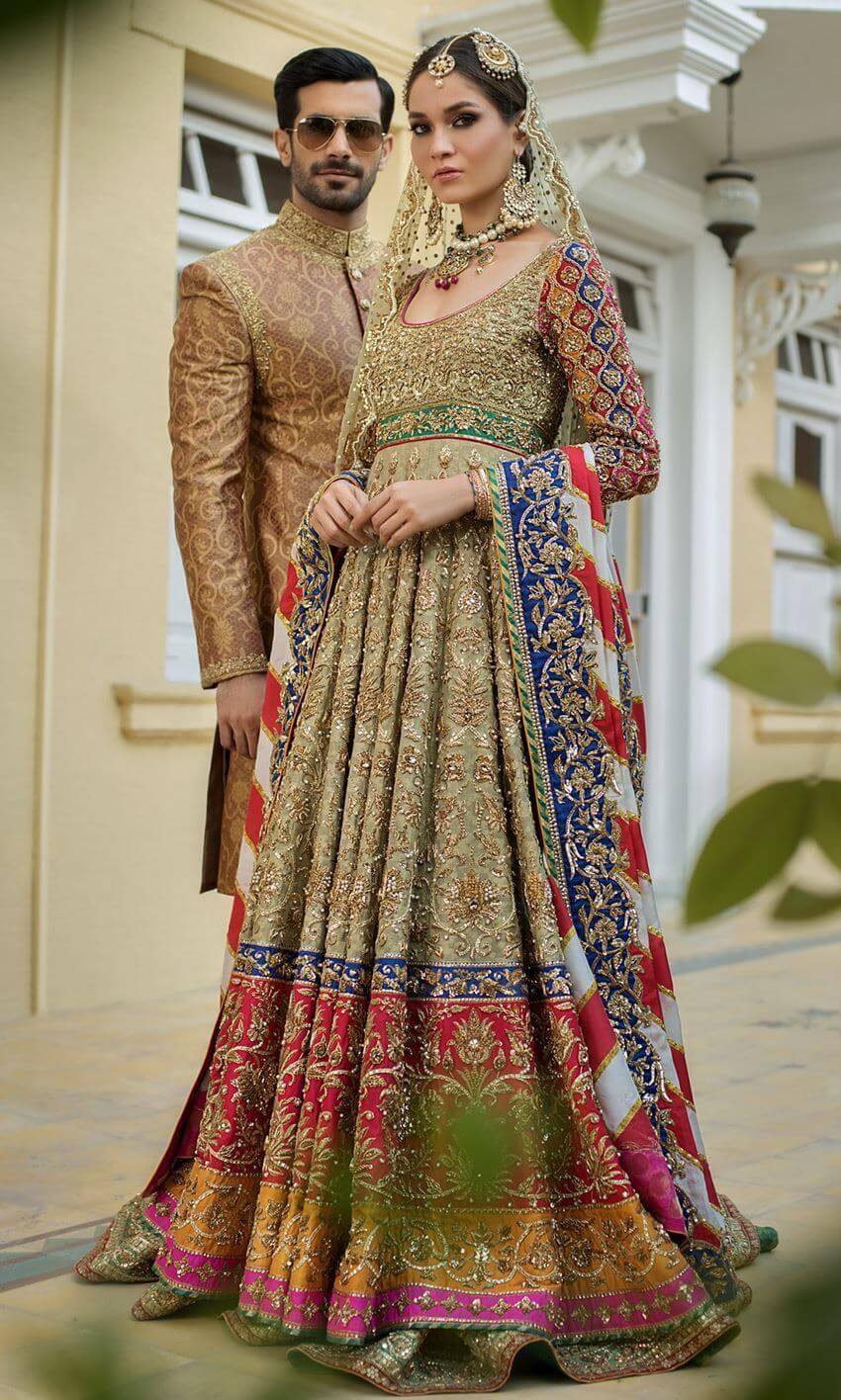 Heavily worked Pakistani bridal pishwas Shehnai by Nomi Ansari